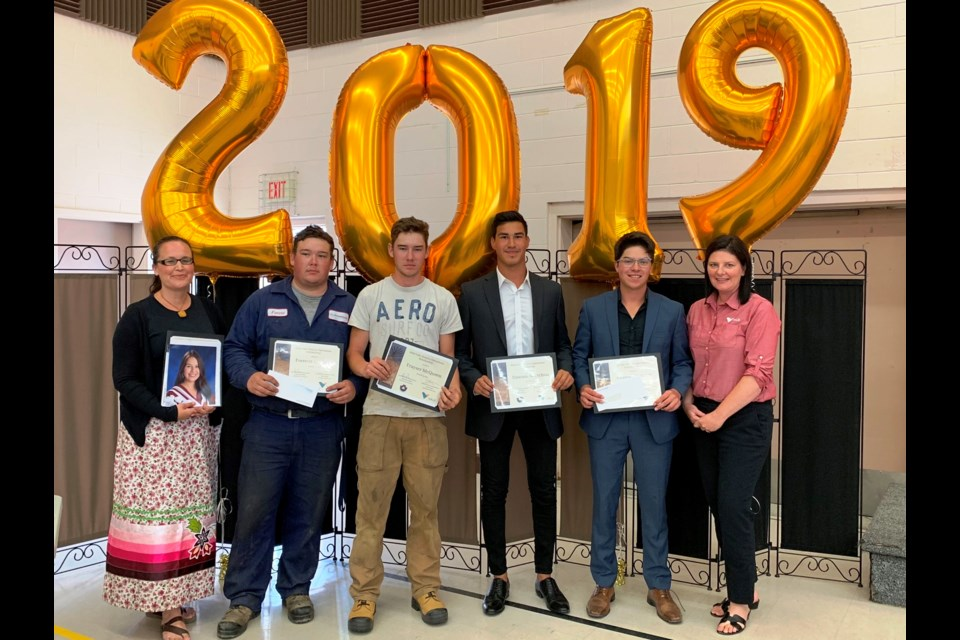 Vale Ontario Operations Scholarship Award winners are (from left): Jennifer Petahtegoose (in place of her daughter Hannah Morningstar), Forrestt McQueen, Frayser McQueen, Dawson Nootchtai, and Conrad Naponse, along with Danica Pagnutti, Vale's senior for corporate and Indigenous affairs. (Supplied photo)