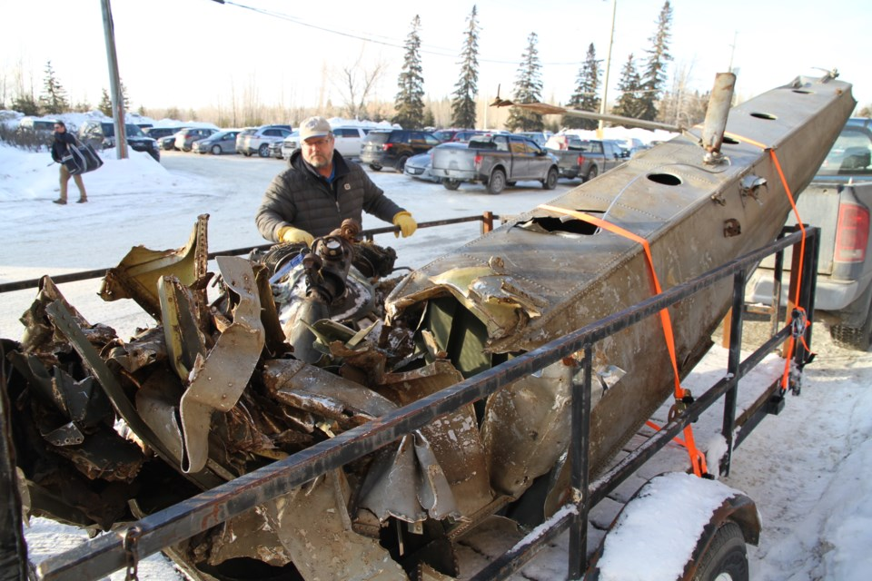 Brian Emblin stands beside the original pontoon from the plane crash wreckage.  It was displayed at a fundraiser at the McIntyre Arena in Timmins this winter, pre COVID-19.  Note the axe hole, police searched for gold as part of the Bill Barilko legend.