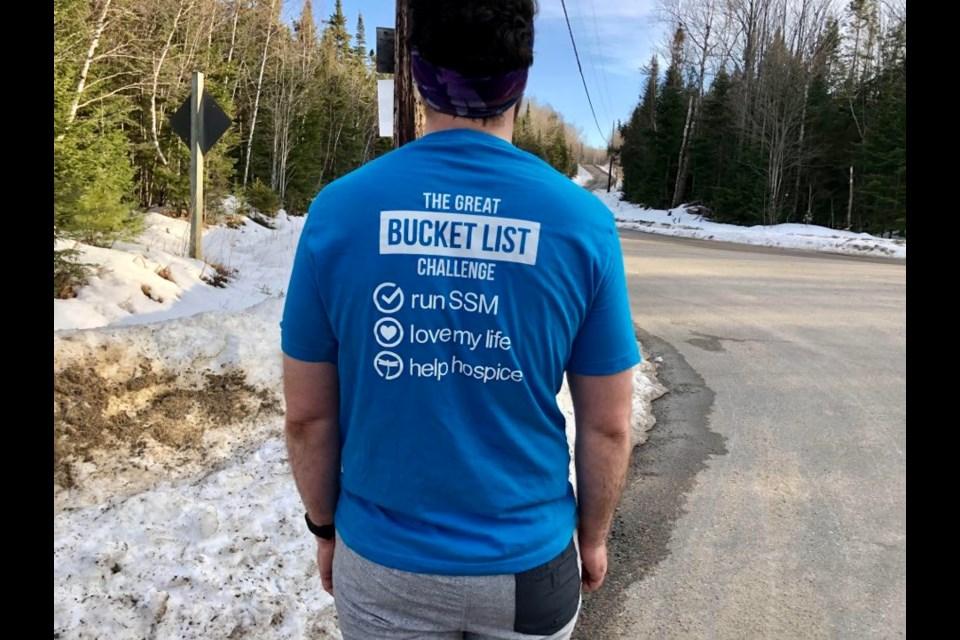 Jonathan Mogg wearing Great Bucket List Challenge Shirt