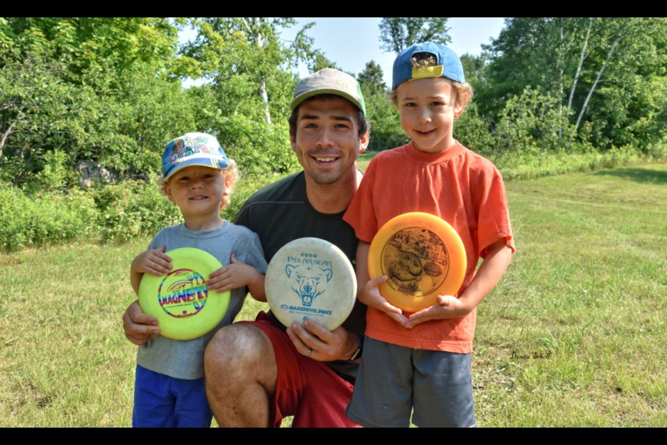 Seth Whitley with his sons, Leo (left) and William (right) opening day