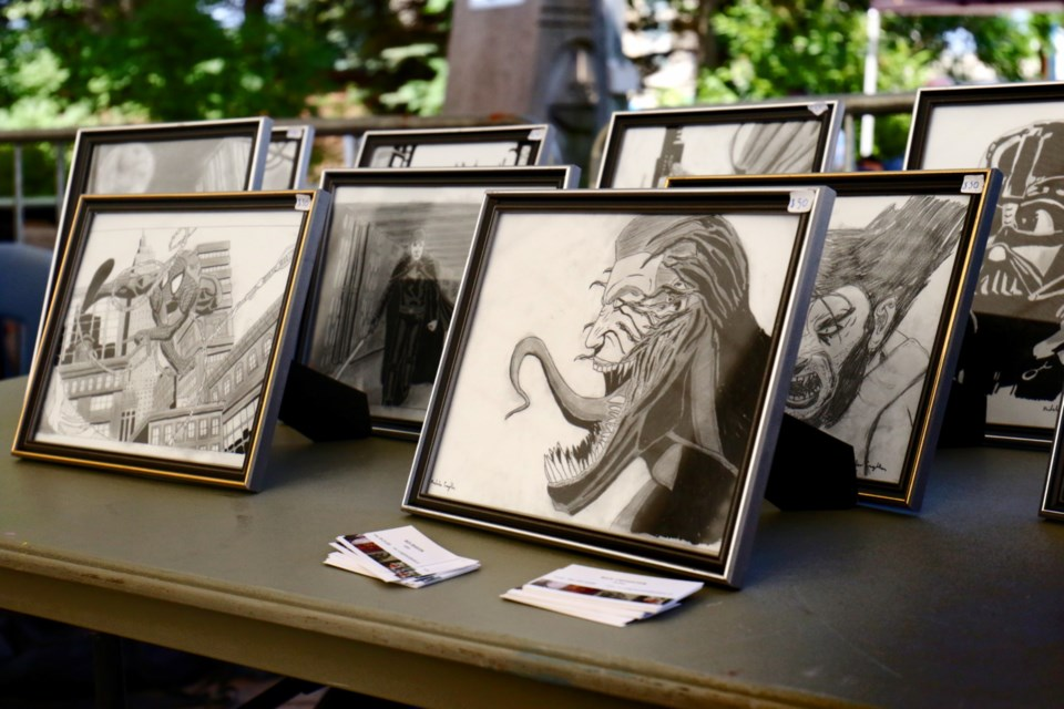 Nick Creighton had a number of comic and pop culture-influenced pieces on display during Art In The Park N' Lot at the Roberta Bondar Pavilion Saturday. James Hopkin/SooToday