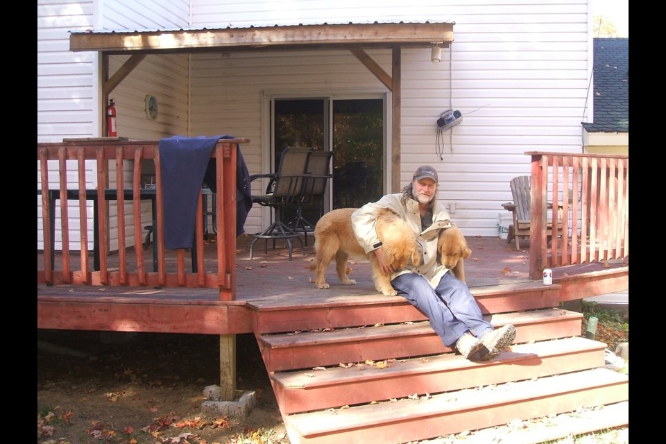Author Glen Cressman with his dogs Karl and Caesar