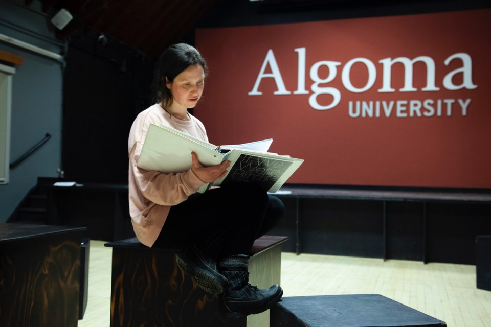 Tova Arbus works on her lines before rehearsal in the Shingwauk Auditorium. Photo provided courtesy of Tova Arbus.