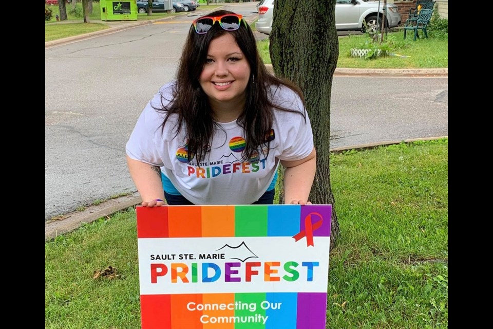 Linsay Ambeault,  Pridefest co-ordinator, displays new lawn signs that allow community member to show support for Sault Ste. Marie's LGBTQ2SI community. Photo provided.