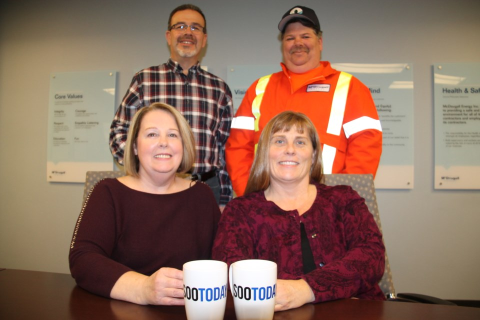 McDougall Energy team members Karen Smith, fuel reconciliation clerk, Jennifer McDougall, human resources director (seated, left to right with their SooToday coffee mugs), Richard Royal, corporate driver training and development manager and Tom Ferragini, fuel/lubricant driver (standing, left to right), March 28, 2018. Darren Taylor/SooToday