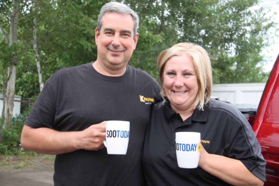 Peter and Brenda Vanboerdonk, Krown Rust Control owner/operators, with their complimentary SooToday coffee mugs, July 26, 2018. Darren Taylor/SooToday
