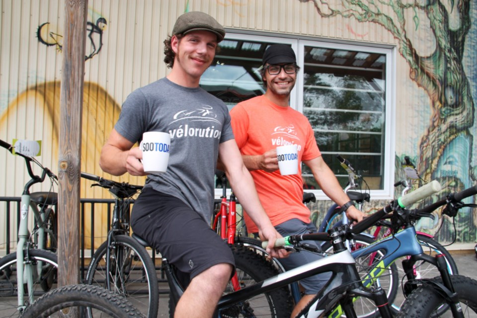 Joel Wenham, Velorution manager, and Jan Roubal, Velorution co-owner/operator, with their complimentary SooToday coffee mugs, Aug. 24, 2018. Darren Taylor/SooToday