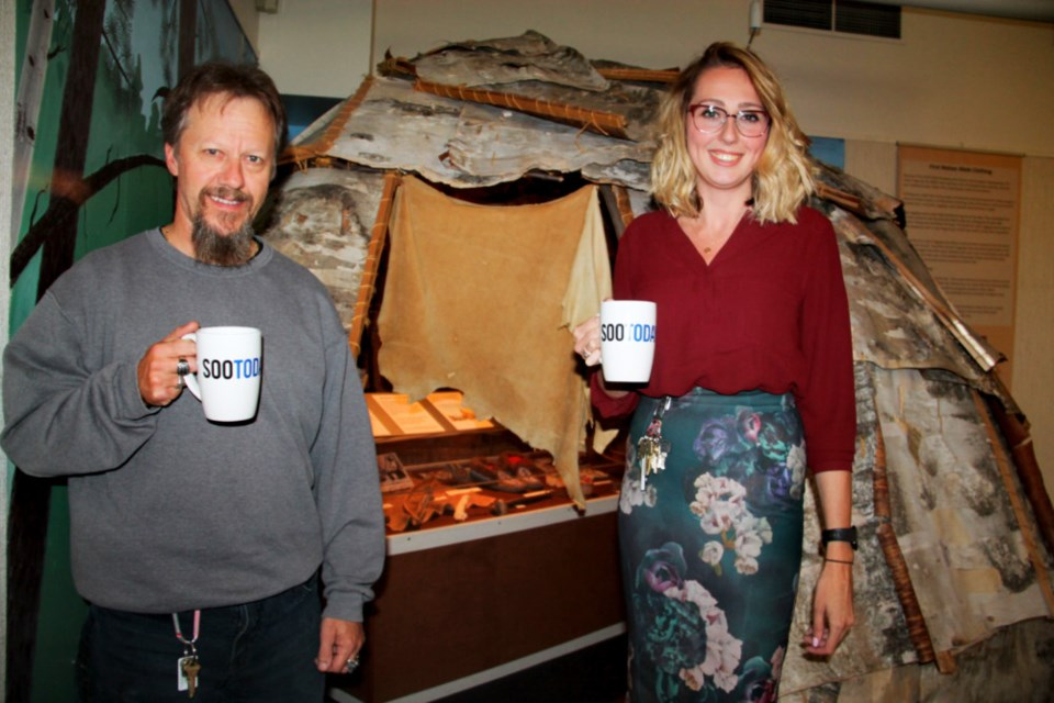 Ric Datson, Sault Ste. Marie Museum assistant curator, and Julia Piskiewicz, Sault Ste. Marie Museum director/curator, with their complimentary SooToday coffee mugs, the museum the subject of this week's SooToday Midweek Mugging, Sept. 7, 2018. Darren Taylor/SooToday