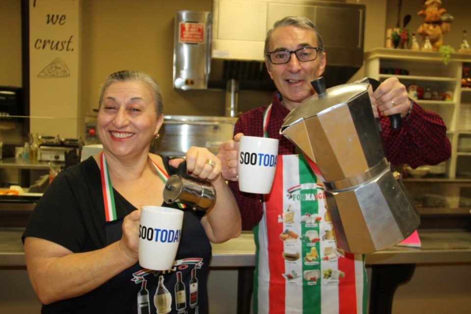Rosetta Sicoli and brother Mauro Sicoli of Nonna's Cucina getting ready to fill up their complimentary SooToday coffee mugs, Dec. 10, 2018. Darren Taylor/SooToday