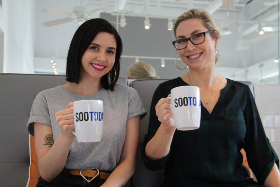 Riley Forsey, The Ten Spot's lead guest coordinator, and April Simard, The Ten Spot's owner/operator, with their complimentary SooToday coffee mugs, Dec. 29, 2018. Darren Taylor/SooToday