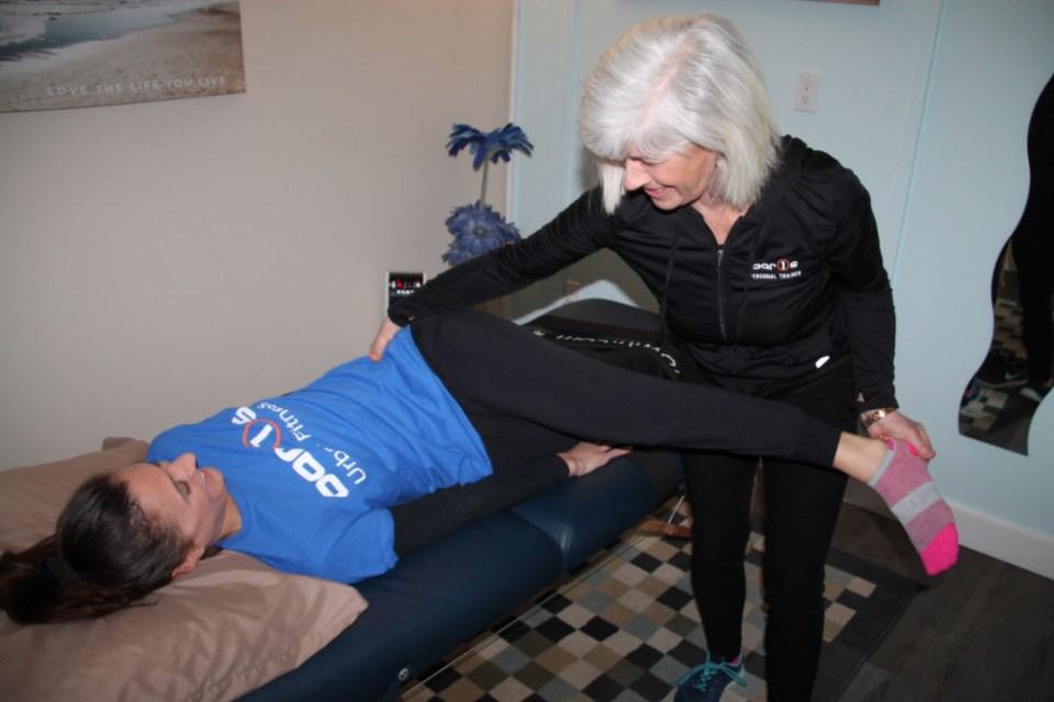 Sandy Piccolo, fascial stretch therapist, performs fascial stretch therapy on Melanie Thorburn, Bar 1's Urban Fitness customer service representative, Feb. 21, 2019. Darren Taylor/SooToday