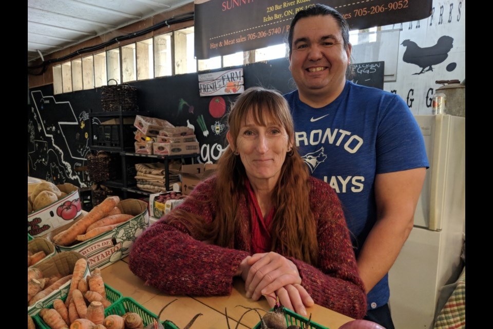 Antoinette Linklater, seen here with husband Simon, sells vegetables, fruit and preserves at the Sunnynook Farms space at Mill Market. Photo taken March 30, 2019. Darren Taylor/SooToday