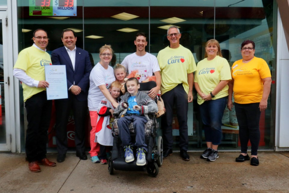 Representatives from McDougall Energy Inc., Children' Wish Foundation of Canada and the Rotary Club of Sault Ste. Marie were joined by Mayor Christian Provenzano and the family of Billy 'Dozer' Adam for Wednesday's cheque presentation at the Trunk Road Esso as part of National C-store Day. James Hopkin/SooToday