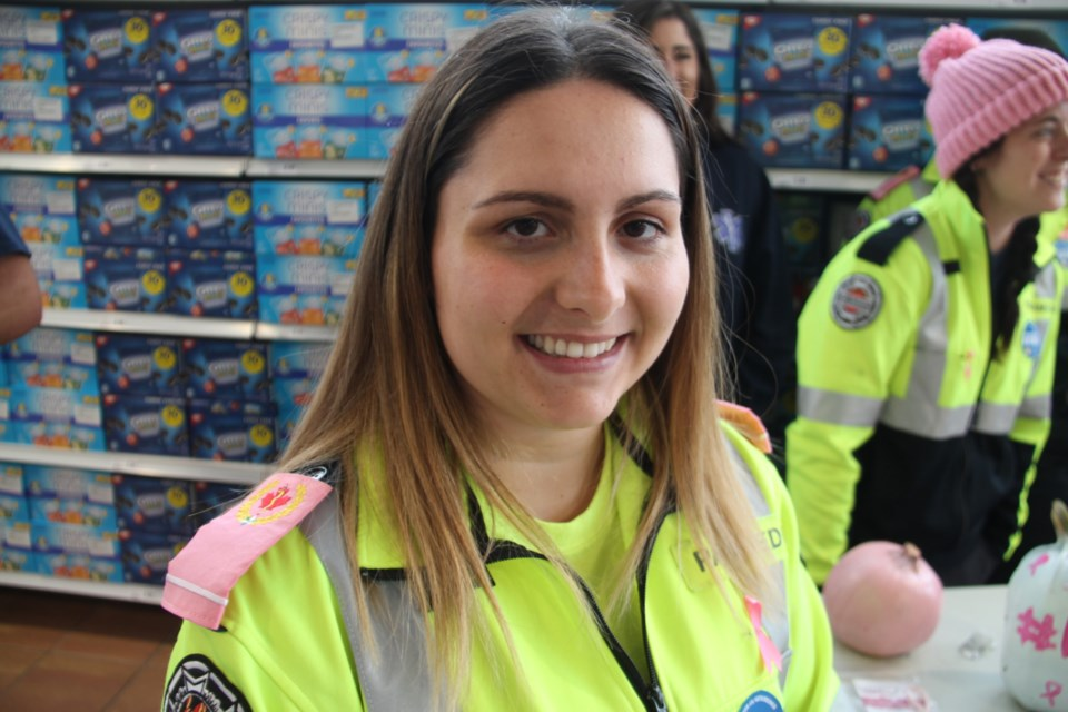 Nicole Levesque, Sault EMS paramedic with pink epaulettes, at Rome's Your Independent Grocer, one of several local paramedics involved in a breast cancer research fundraiser, Oct. 12, 2019. Darren Taylor/SooToday