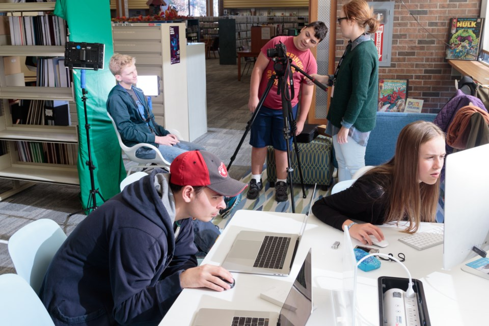 Homeschooled students using digital tools at the Sault Ste. Marie Centennial Library's 'digital maker space'. (From left) Isaac Withers, 14, Ezra Smith, 18, Ewyn Smith, 13, program lead Katie Huckson, and Sydney Hopkins, 13. Jeff Klassen/SooToday