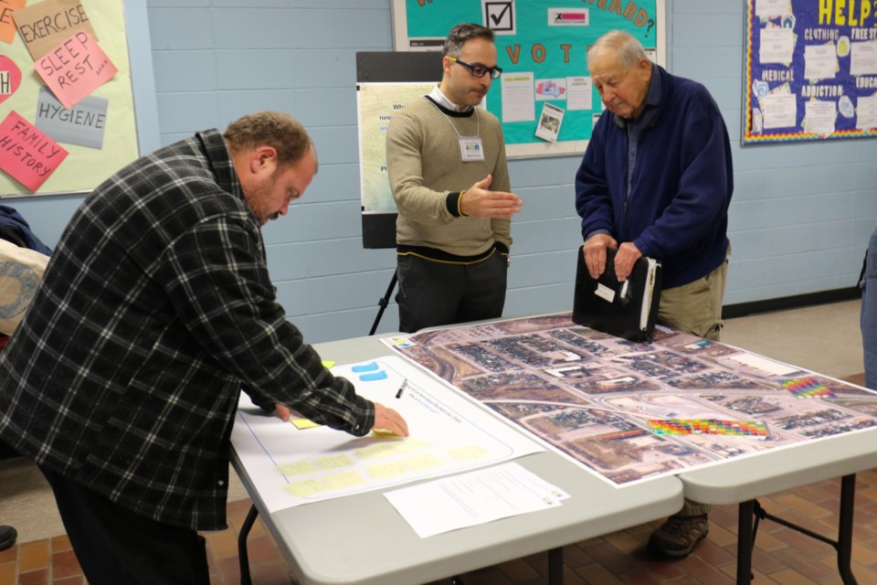 City of Sault Ste. Marie Senior Planner Steve Turco, middle, speaks with people during a public imput session on the Jamestown neighbourhood Wednesday. James Hopkin/SooToday