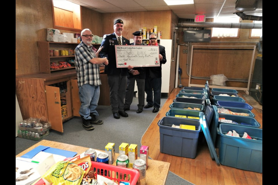 Provided picture shows Rev. Adrian Collins and R.C.L. Br. 374 President Dave Pearse holding prepared food bins; Rev. Adrian Collins accepting a $265 donation from Legion President Dave Pearse; Secretary Mark Trainor and Comrade John Shannon.