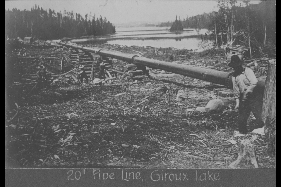 This historic photo shows the construction of the compressed air pipeline. Remnants remain near Giroux Lake.