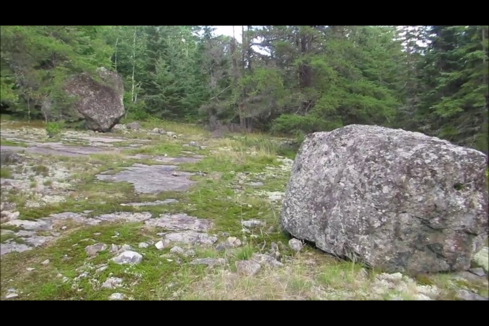 These are two of the four aligned boulders found on the shores of Larder Lake.