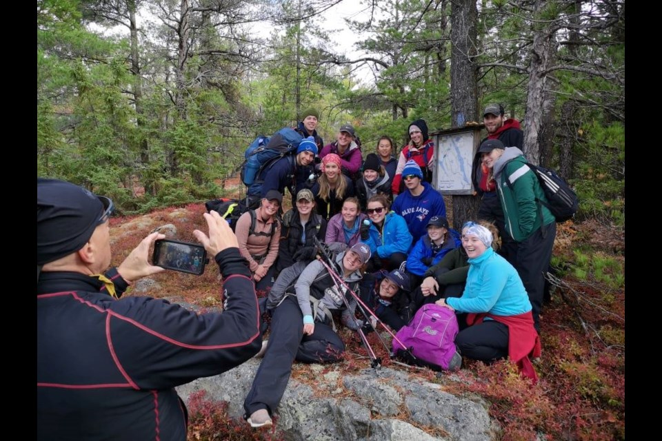 Having fun and being happy is an important part of being outside on outside education trips.  These Nipissing University BPHE students are part of a fall hiking trip with Back Roads Bill.