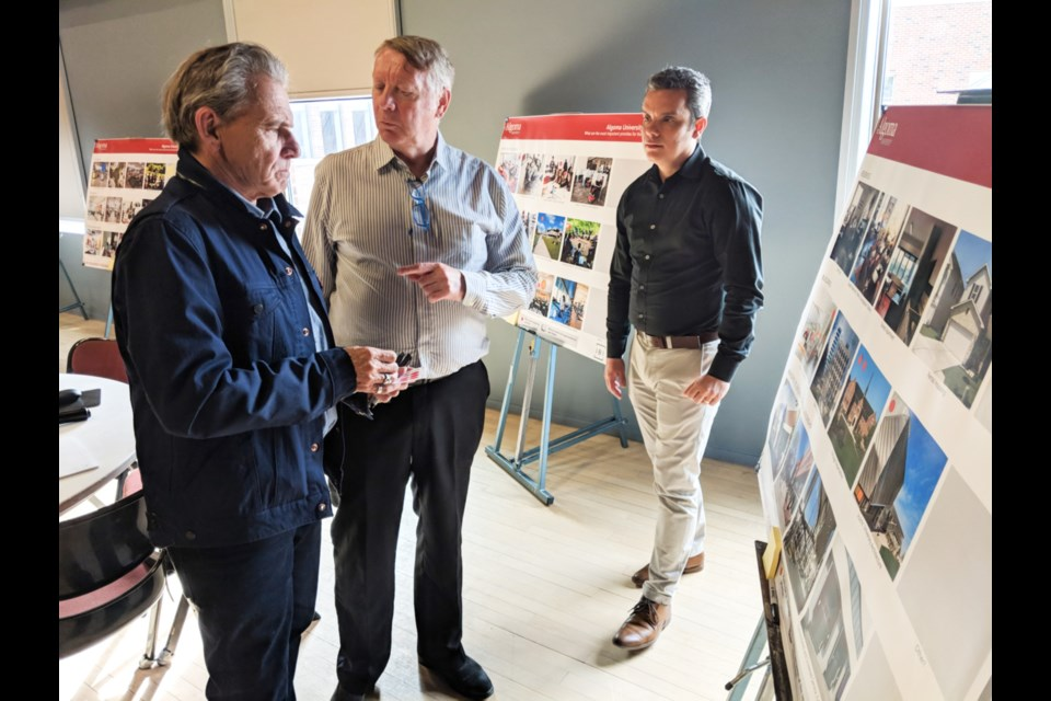 Tom O'Flanagan, Algoma University visual arts associate professor, speaks with architects David Ellis and Jorge Garcia at a town hall meeting held at Algoma University to gather input as to how the Sault campus should look over the next 10 years, July 11, 2019. Darren Taylor/SooToday