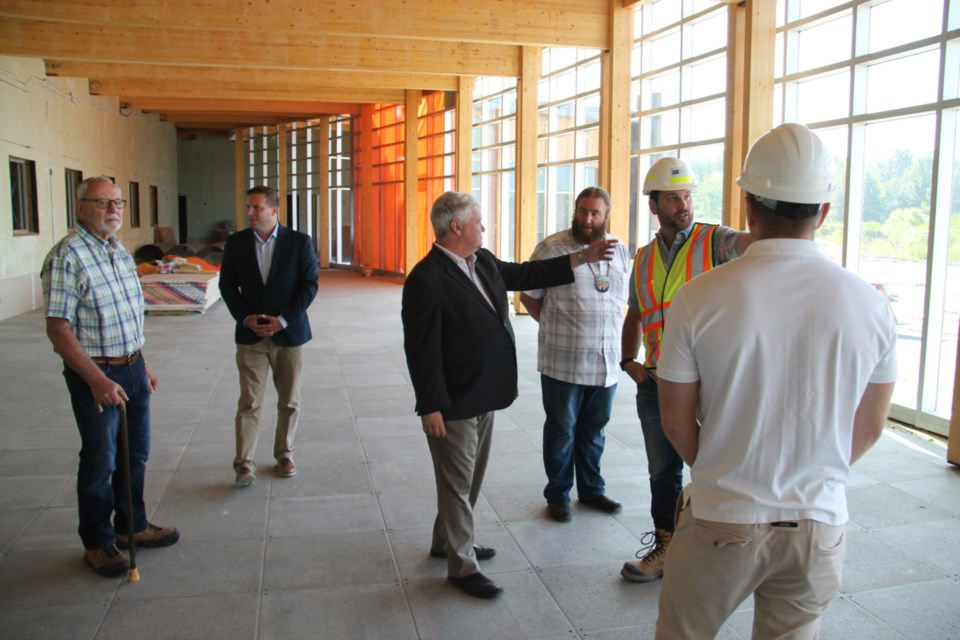 Marco Mendicino, Parliamentary Assistant to the federal Minister of Infrastructure (second from left) and Sault MP Terry Sheehan on a tour of the soon to be completed Anishinaabe Discovery Centre, July 3, 2019. Darren Taylor/SooToday