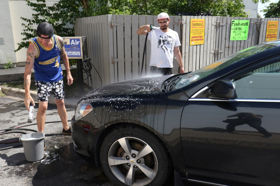 Brenton George Ellis of local musical act Dynowaves, left, and OH!No music festival founder Jamie Vincent were washing cars at the Trunk Road Esso Saturday to raise funds for OH!No '19. The two-day event happens in Leeburn Sept. 6-7. James Hopkin/SooToday