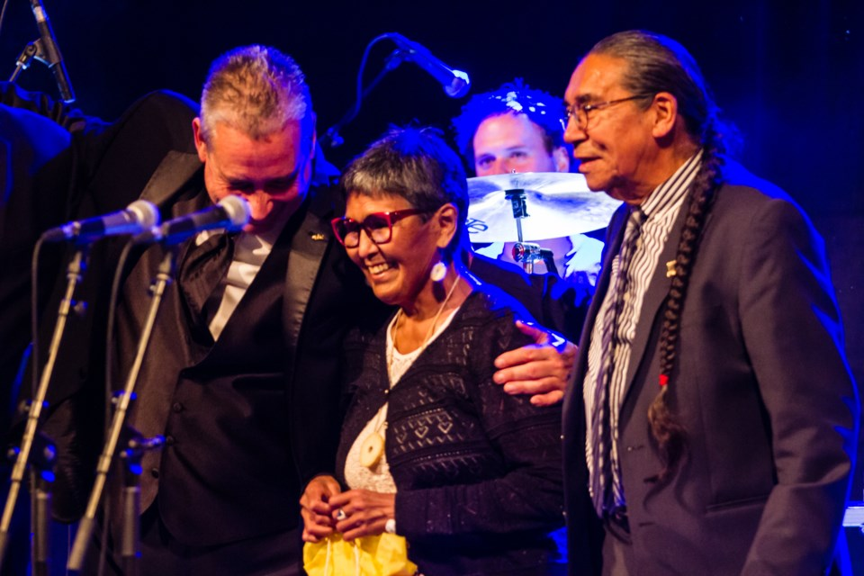 Edna Elias, former commissioner of Nunavut, is presented with a birthday gift prior to the Jerry Cans' performance at the Machine Shop on Wednesday, Oct. 9, 2019. Donna Hopper/SooToday