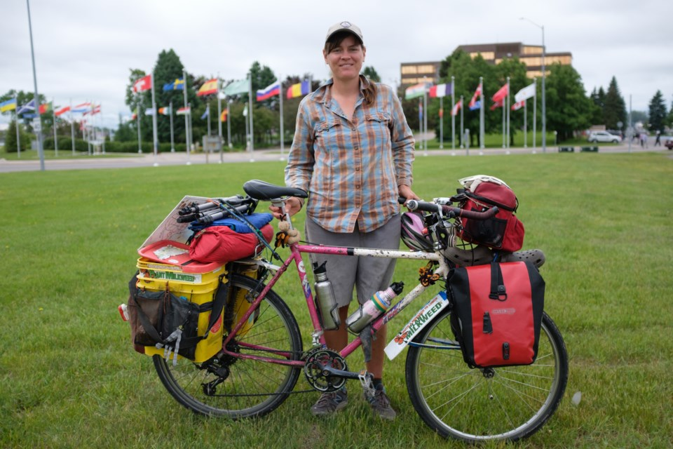 Sarah Dykman in the park in front of city hall in Sault Ste. Marie. Dykman was in the Sault on June 19 as part of her 16,000 km Butterbike tour. The seasonal biologist is following the seasonal migration of monarch butterflies to raise awareness about their population decline.