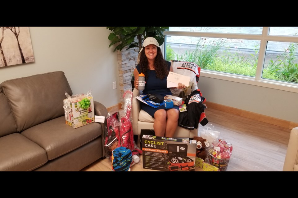 Julie Premo with just some of the amazing prizes cyclists can win at the Great Bucket List Cycle thanks to the generosity of local businesses. Sandi Wheeler/SooToday