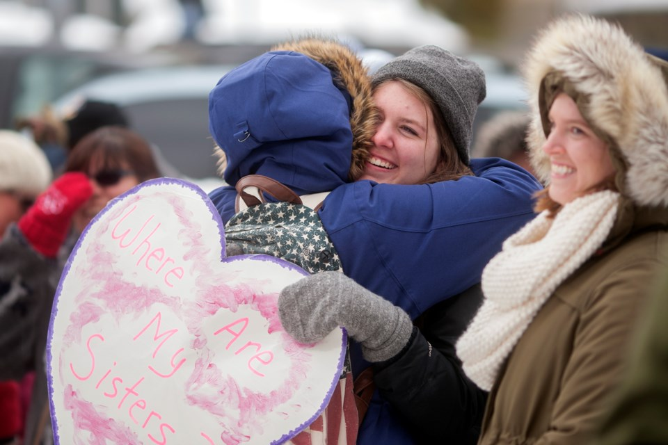 Women hug during the Murdered and Missing Indigenous Women Memorial and March held Feb. 14, 2017 in front of the Sault Ste. Marie Courthouse. Kenneth Armstrong/SooToday