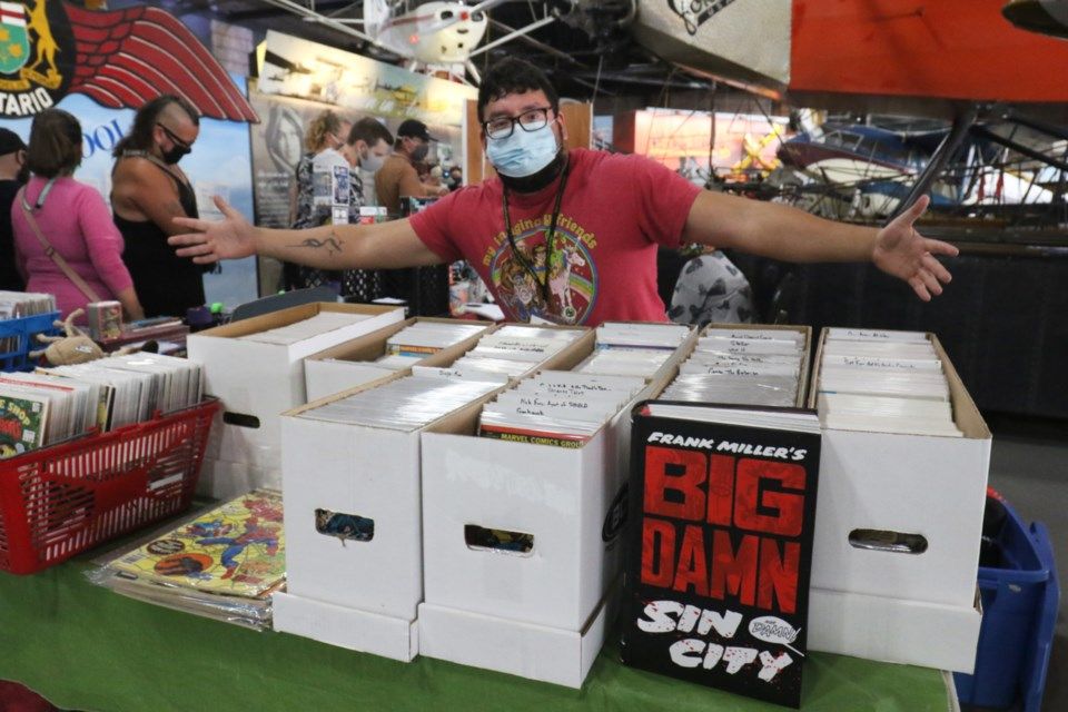 EB Comics owner and The Rad Zone employee Evan Belleau with his stash of comic books.