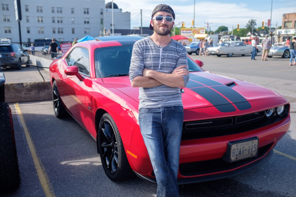 Zach Huckerby and his 2016 Dodge Challenger RT parked before the 2017 Queen Street Cruise on June 16. Jeff Klassen/SooToday