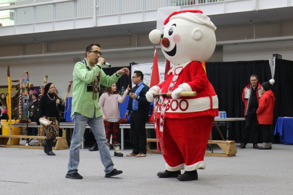 Sault College Pow Wow MC Joel Syrette introduces Mr. Bon Soo during Saturday's mascot dance-off. James Hopkin/SooToday