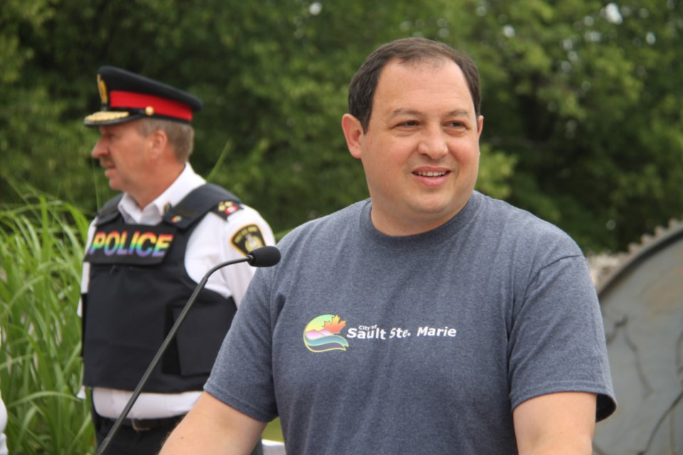 Sault Mayor Christian Provenzano, with Sault Police Chief Hugh Stevenson at rear, at the opening of Pridefest, July 22, 2018. Darren Taylor/SooToday