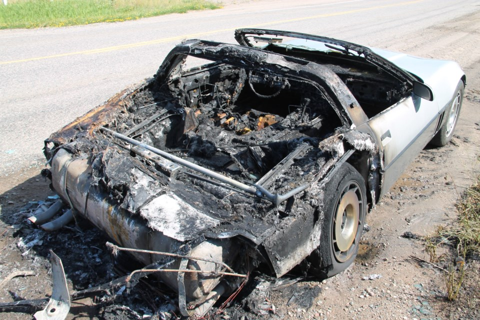 Fire resulting from an apparent mechanical failure destroyed this 1985 Corvette in a single-vehicle accident at Second Line and Airport Road, July 4, 2016. Darren Taylor/SooToday