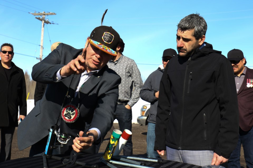Black Fox Fishing owner Brendan Syrette, left, gives Sault Ste. Marie MPP Ross Romano a demonstration of The Trigger during a funding announcement in Batchewana First Nation Friday. James Hopkin/SooToday