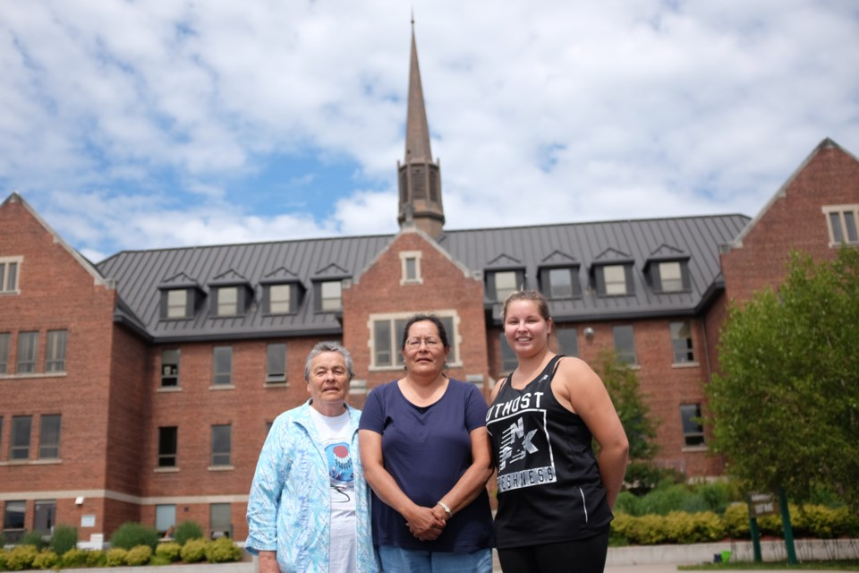 (From left) Susie Jones, her daughter Joy Susan Carr, and Jones' granddaughter Taylor Jones. Susie Jones attended Shingwauk Residential School from 1941 until 1953. Taylor Jones' great great grandfather, her great grandfather, and her grandfather and grandmother attended residential schools. Photo by Jeff Klassen for SooToday