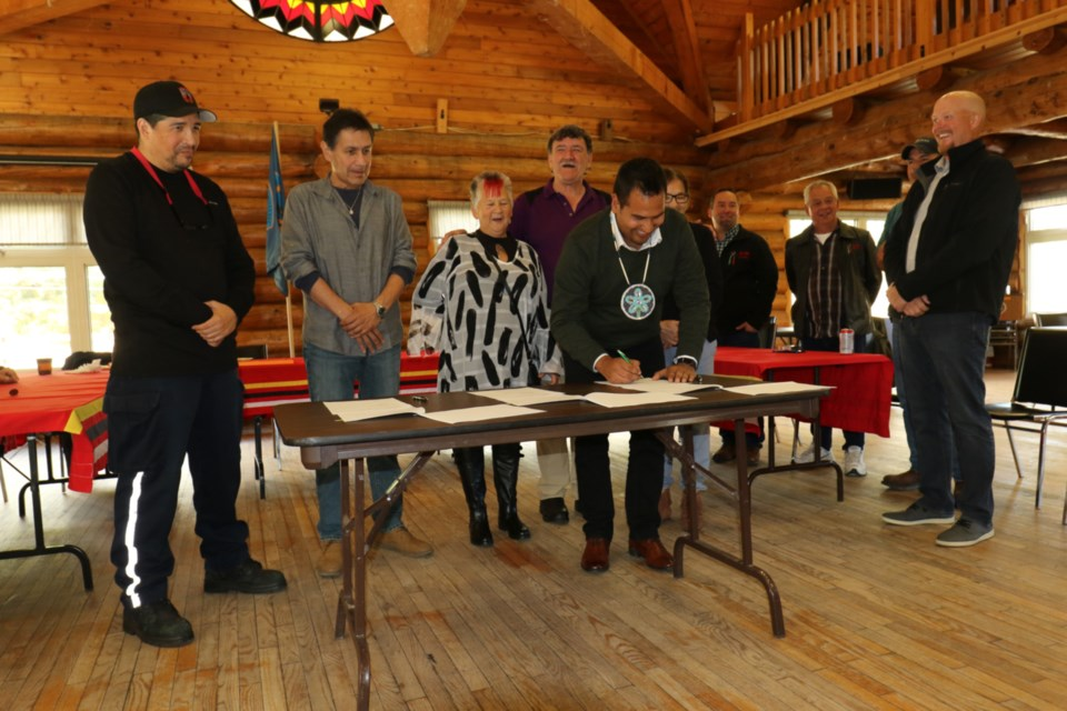 Garden River First Nation Chief Andy Rickard signs a memorandum of understanding Thursday between Garden River, Shwe Miikaan and Miller Paving for the resurfacing of Highway 17 and Highway 17B, which run through the First Nation. The signing ceremony was held at the Garden River Community Centre. James Hopkin/SooToday