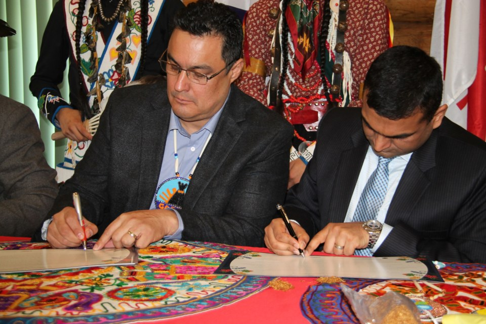 Paul Syrette, Garden River First Nation chief, and Anshumali Dwivedi, Port of Algoma CEO, at the Reconciliation and Prosperity Accord signing, Garden River First Nation, April 16, 2016. Darren Taylor/SooToday