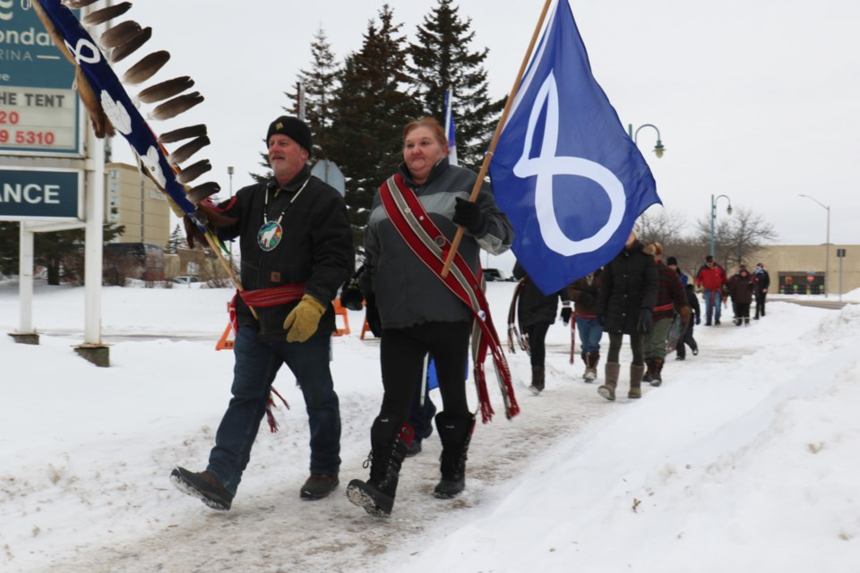 Historic Sault Ste. Marie Metis Council Chair Steve Gjos, left, and president Kim Powley lead members of the Metis community to city hall in order to raise the Metis Nation of Ontario flag in hnour of Louis Riel Day. James Hopkin/SooToday