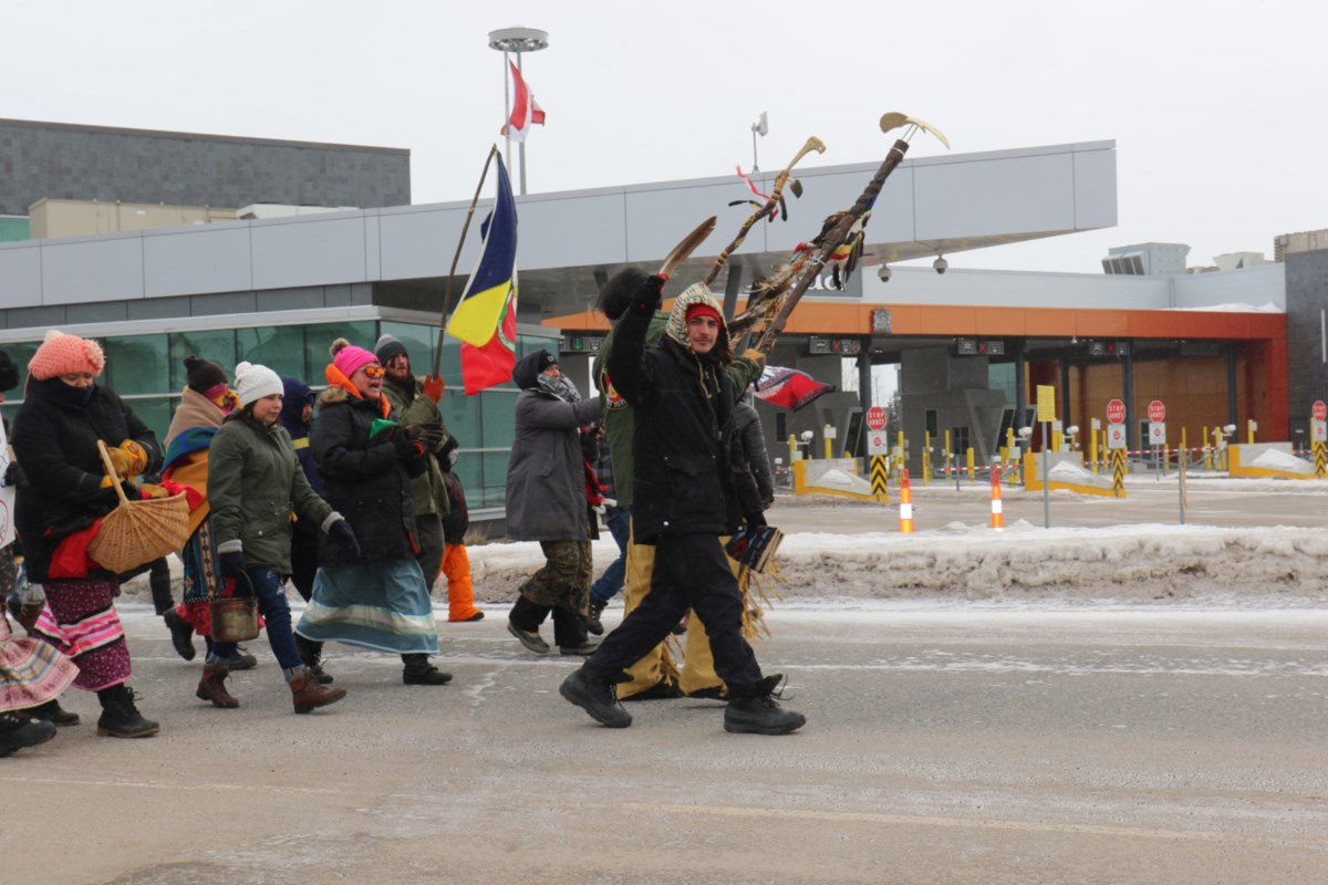 Wet'suwet'en supporters walk International Bridge for water ceremony (12 photos)