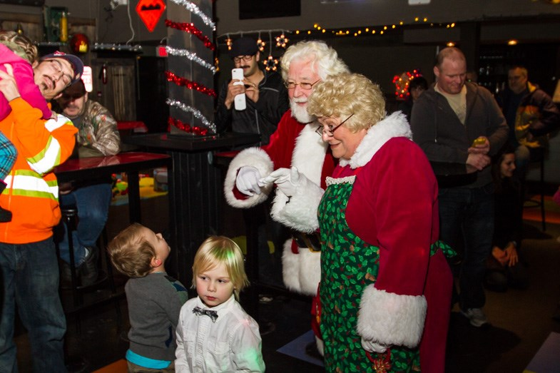 Santa and Mrs. Claus were greeted by a crowd of kids at the 3rd annual Toystock Christmas Cheer benefit at the Canadian Night Club on Sunday, November 30, 2014. Donna Hopper/SooToday