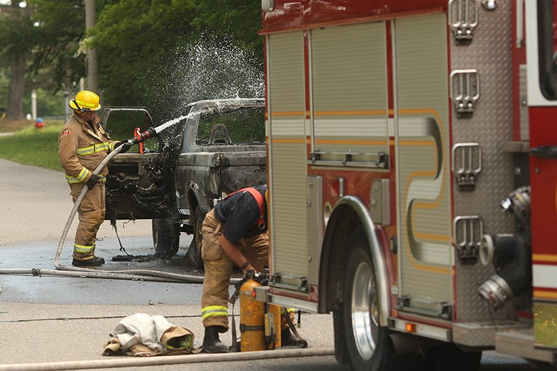 Firefighters dowse a truck fire in the White Pines Collegiate and Vocational School driveway on Sunday, July 26, 2015. Ken Armstrong/SooToday
