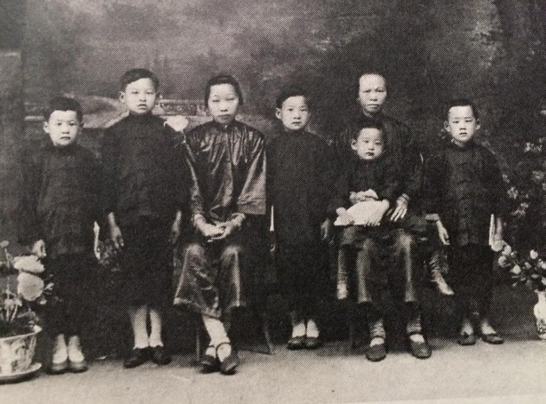 Lewis Chow is shown second from left, in this portrait taken in China after his mother died in 1925. His brother King is at the far left.