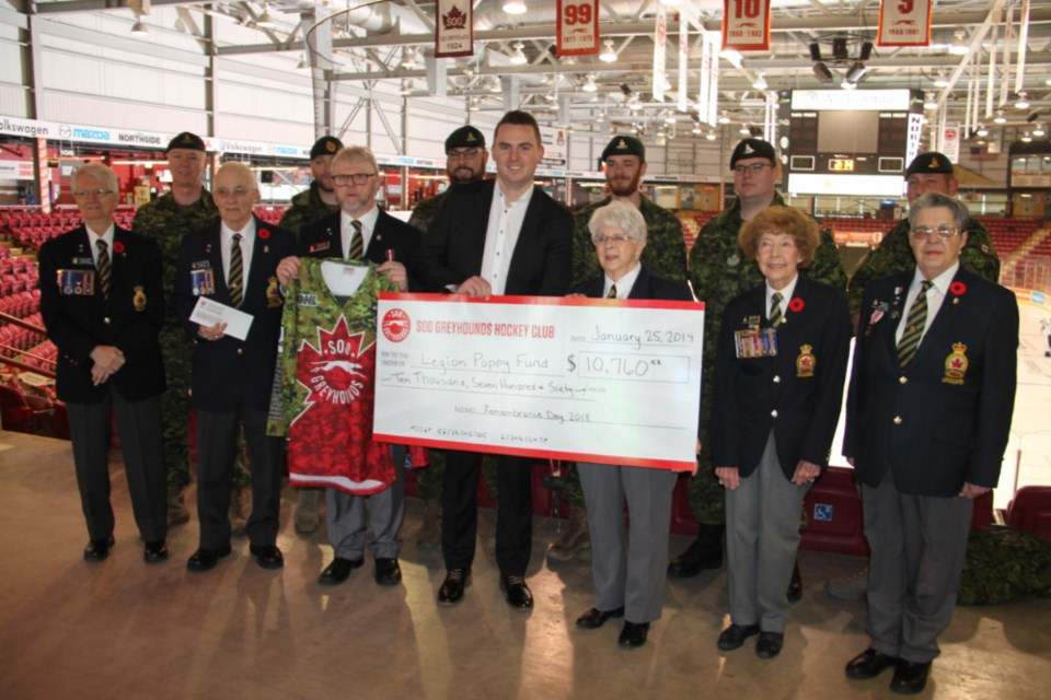 Kyle Raftis, Soo Greyhounds general manager, presents a cheque for $10,760 on behalf of the hockey club to Royal Canadian Legion Branch 25 officials for the Branch's Poppy Fund, Jan. 25, 2019. Darren Taylor/SooToday