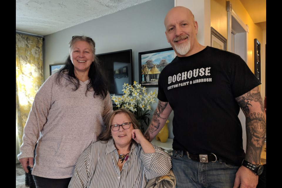 Sault veteran Kelley Westlake, centre, with sister Penny Westlake and artist/friend Dave Ostrowski-Gallant, March 27, 2019. Darren Taylor/SooToday
