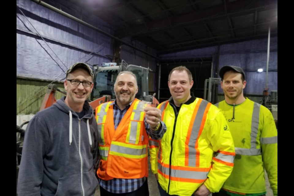 GFL Environmental's Dan DiPietro, John Martella, Chris Dovigi and Andrew Miron, Martella holding up a Sault woman's lost diamond ring retrieved from 40 tonnes of recyclable paper items at GFL's Sackville Road plant, March 26, 2020. Photo supplied