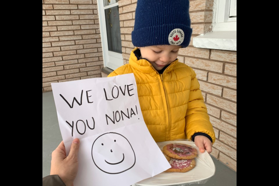 Two-year-old Hudson Forbes checked in on his great-grandmother Anna Nardini, currently protecting herself from the COVID-19 virus by staying indoors, and cheered her with a delivery of homemade cookies, March 18, 2020. Photo supplied by Brianna Forbes