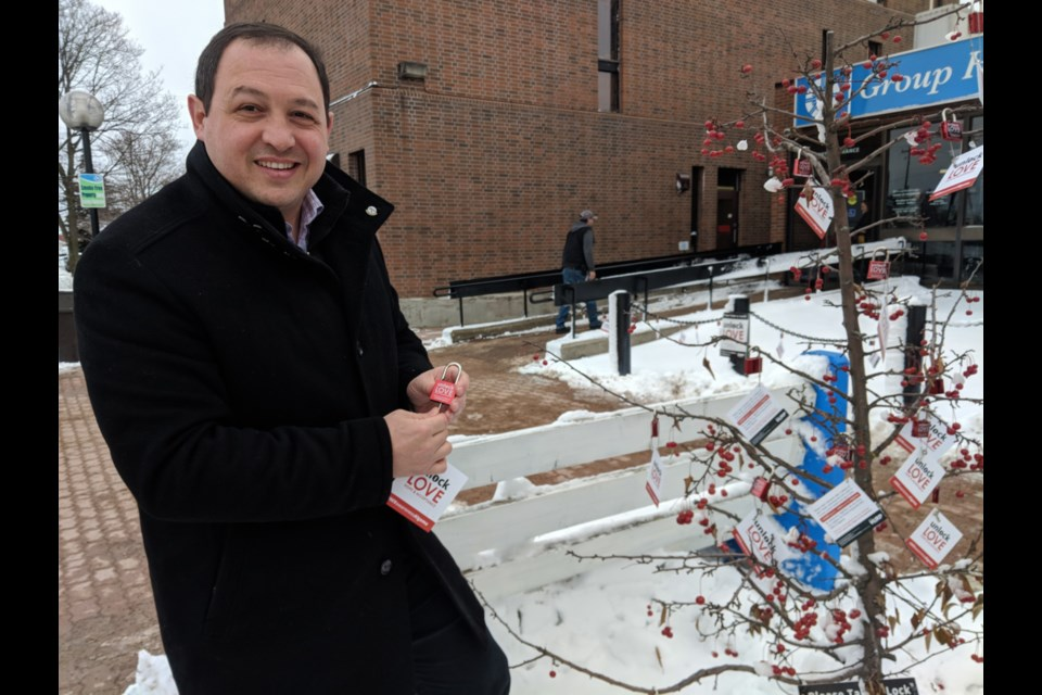Sault Mayor Christian Provenzano picks up his free lock to show support for people living with HIV, Nov. 29, 2019. Darren Taylor/SooToday